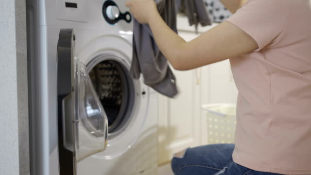 woman are using washing machines - appliance stock videos & royalty-free footage