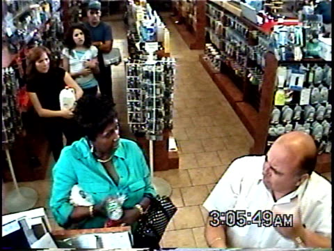 ha ws woman arguing with senior man in convenience store while other customers wait in line in behind him / brooklyn, new york, usa - fare la fila video stock e b–roll