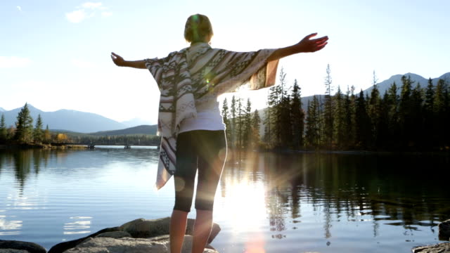 woman arms outstretched by the lake at sunrise - jasper national park stock videos & royalty-free footage