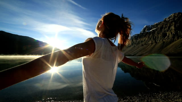 woman arms outstretched by the lake - banff national park stock videos & royalty-free footage