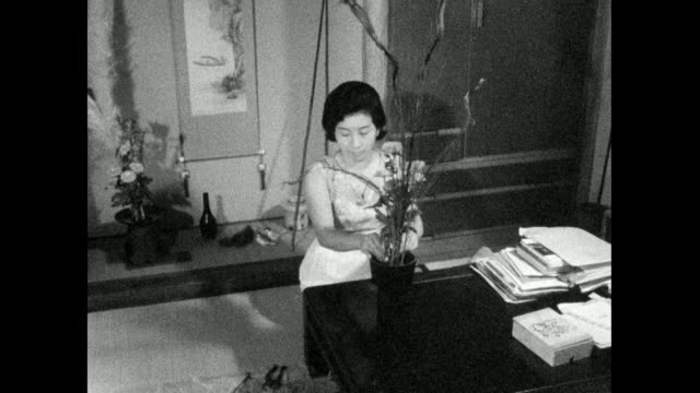 woman arranges flowers at home in japan; 1966 - only mid adult women stock videos & royalty-free footage