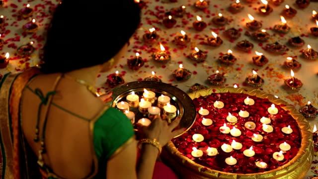 vídeos y material grabado en eventos de stock de ms woman arranging diyas decoration in brass container during diwali festival - bandeja para servir