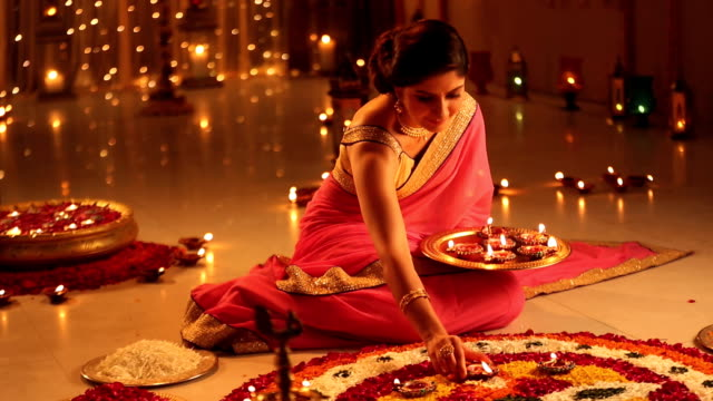 ms pan woman arranging diyas during diwali festival - 盆点の映像素材/bロール