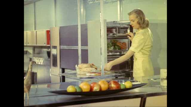 ms woman arranging food in refrigerator in futuristic kitchen / united states - kitchen worktop stock videos and b-roll footage