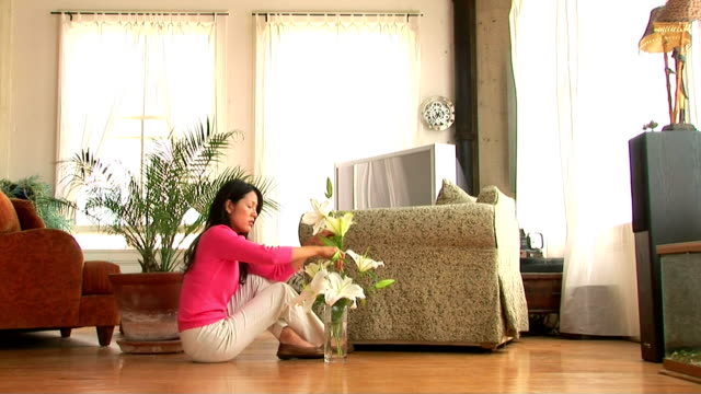 woman arranging lilies - stargazer lily stock videos & royalty-free footage