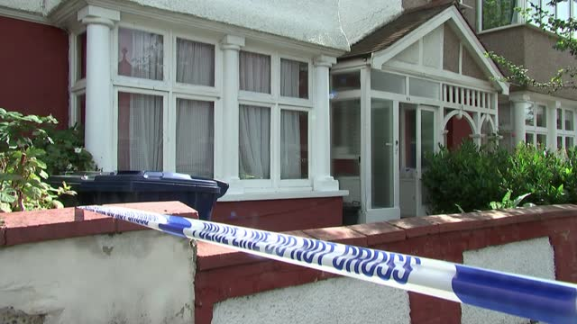 woman arrested on suspicion of murder after five-year-old girl found dead; england: west london: ealing: leyborne avenue: ext police officer and... - crime and murder stock videos & royalty-free footage