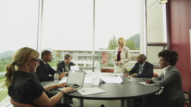 WS DS Woman arriving at business meeting in board room, Squamish, British Columbia, Canada