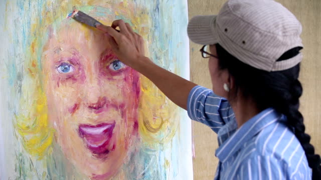 woman artist oil painting portrait - oil paint stock videos & royalty-free footage