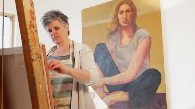 ms tu td woman artist painting in her studio / lamy, new mexico, united states - only mature women stock videos & royalty-free footage