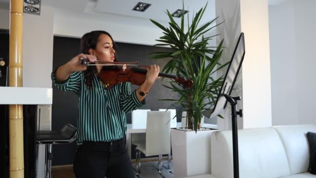 woman artist playing violin at home - violin stock videos & royalty-free footage