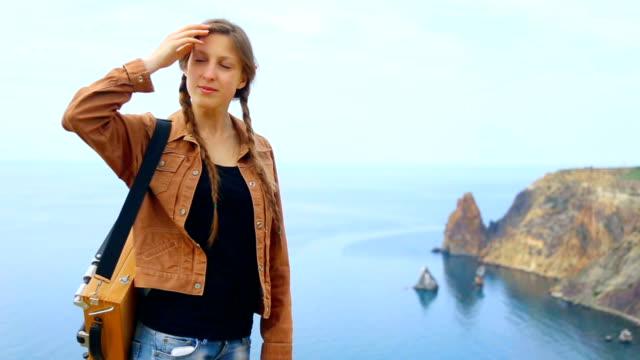woman artist travels along the coast