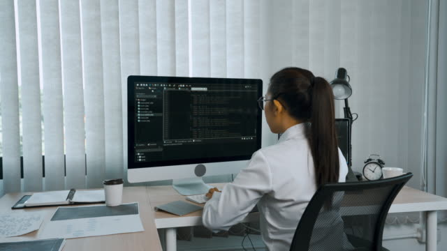 woman asian software developers are analyzing about the code written into the program on the computer in office room. - indonesia stock videos & royalty-free footage