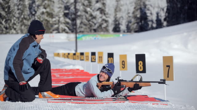 ms pan woman asking to instructor than shooting / whistler ,bc ,canada - biathlon stock videos and b-roll footage