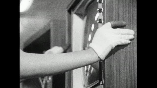 cu woman assembles and tests television in factory; 1966 - 科学技術点の映像素材/bロール
