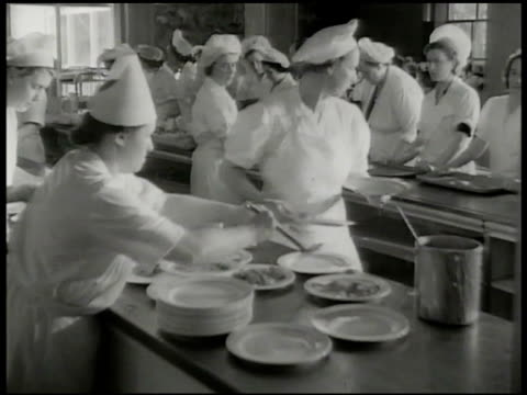 woman assembling boxes on machine cafeteria workers plating food in factory dining area ws employees eating in communal dining hall labor leaders ws... - chocolate factory stock videos & royalty-free footage