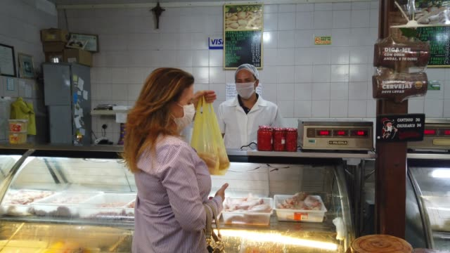 woman at a butcher shop. butcher is atending her. - retail occupation stock videos & royalty-free footage