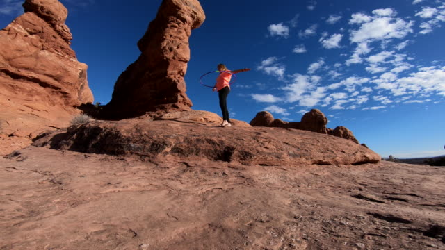 woman at arches national park - arches national park stock videos & royalty-free footage