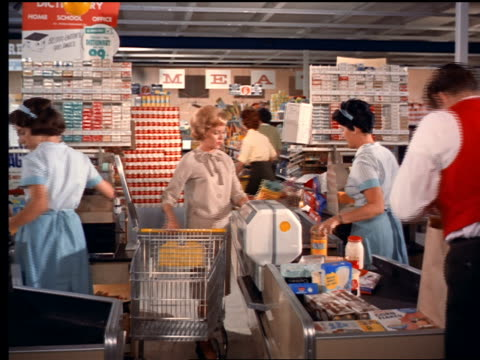 1962 woman at check-out with cashier ringing up groceries and bag boy bagging them in store - food processing plant stock videos and b-roll footage