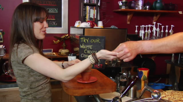 vídeos de stock, filmes e b-roll de ms woman at coffee shop counter getting change and carrying away pastry served in flower pot/ vancouver, bc - kelly mason videos
