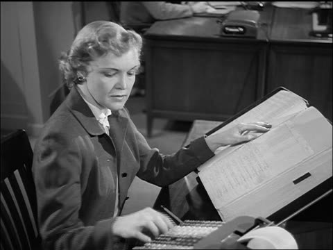 b/w 1952 woman at desk in office using calculator + ledger book - rechenmaschine stock-videos und b-roll-filmmaterial