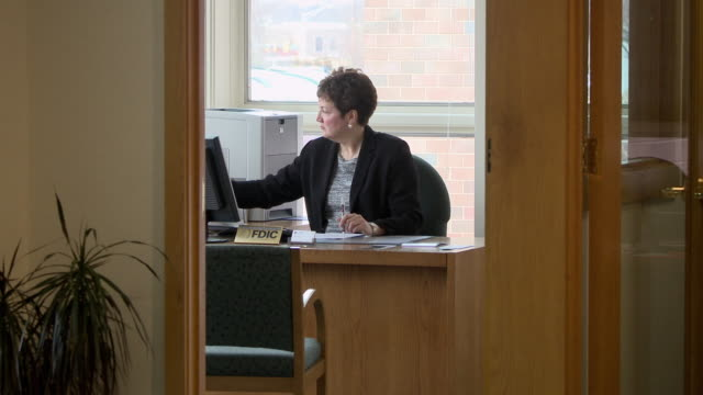 ms woman at desk, writing, typing on keyboard, bethlehem, pennsylvania, usa - bethlehem pennsylvania stock videos and b-roll footage