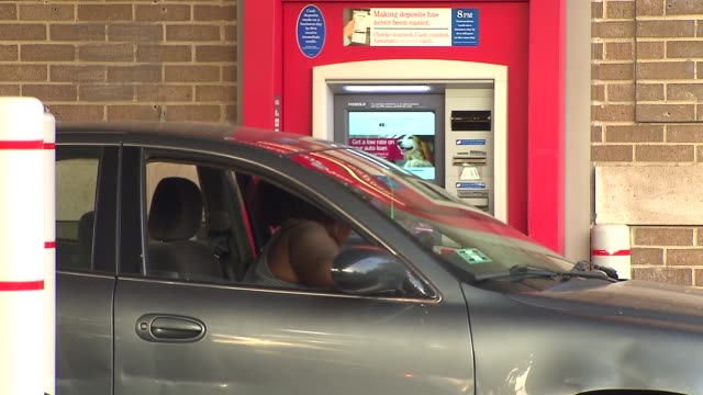 woman at drive up atm - bank of america stock videos & royalty-free footage