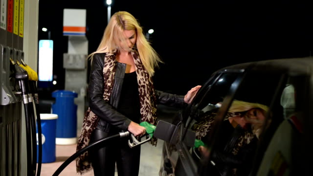 woman at gas station - refuelling stock videos & royalty-free footage