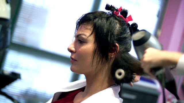 woman at hairdressing salon. - blow drying hair stock videos and b-roll footage