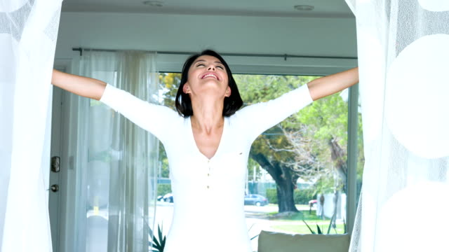 Woman at home enjoying some fresh air