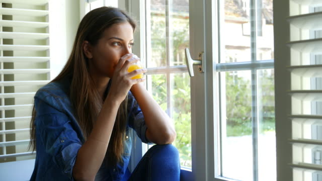 woman at home looking through the window - juice drink stock videos & royalty-free footage