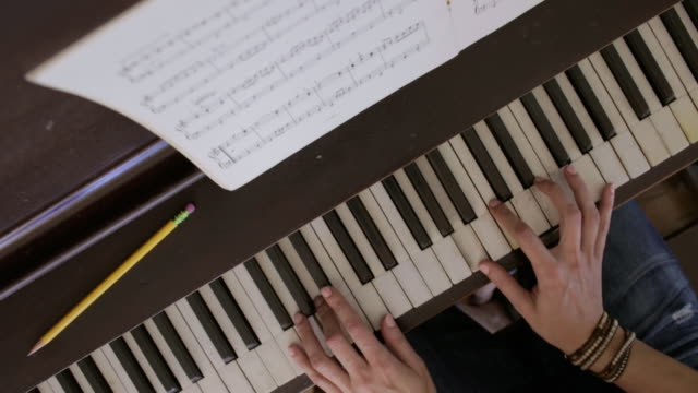 woman at home - piano key stock videos & royalty-free footage