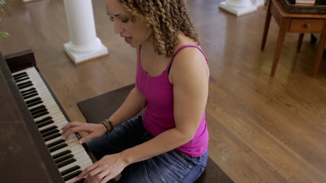woman at home - piano stock videos and b-roll footage