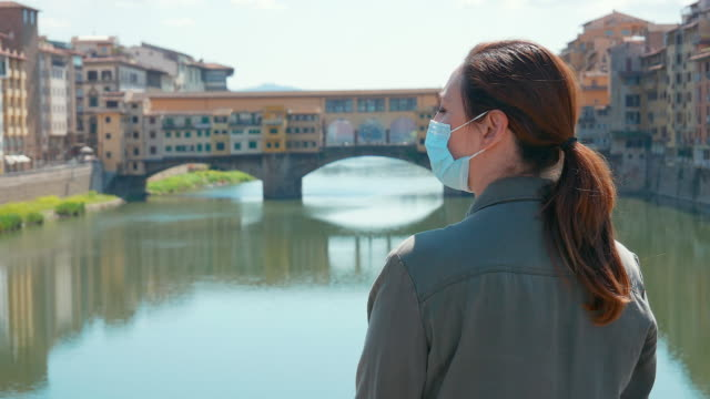 woman at ponte vecchio - ponte stock videos & royalty-free footage