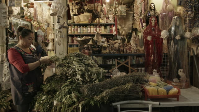 woman at religious store in mexico - afterlife stock videos and b-roll footage