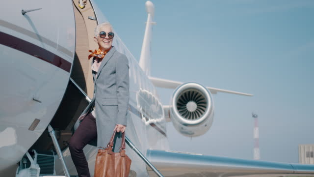 woman at the airport - senior women stock videos & royalty-free footage