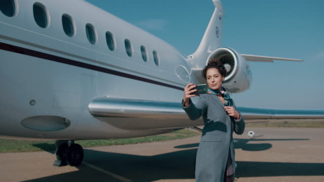 woman at the airport - corporate jet stock videos & royalty-free footage