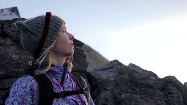 woman at the mount kinabalu summit montage - mt kinabalu stock videos and b-roll footage