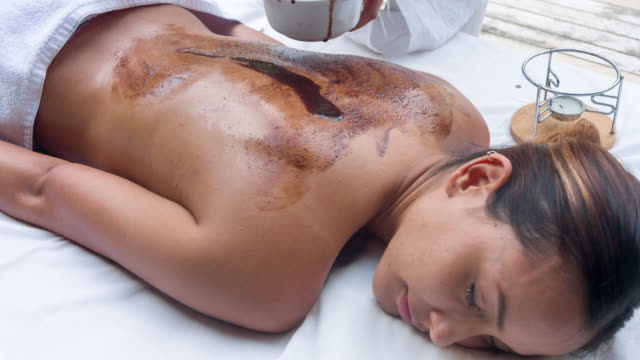 woman at the spa getting a back massage - exfoliation stock videos & royalty-free footage