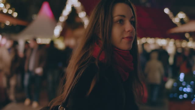 woman at traditional christmas market in berlin, germany - market stall stock videos & royalty-free footage