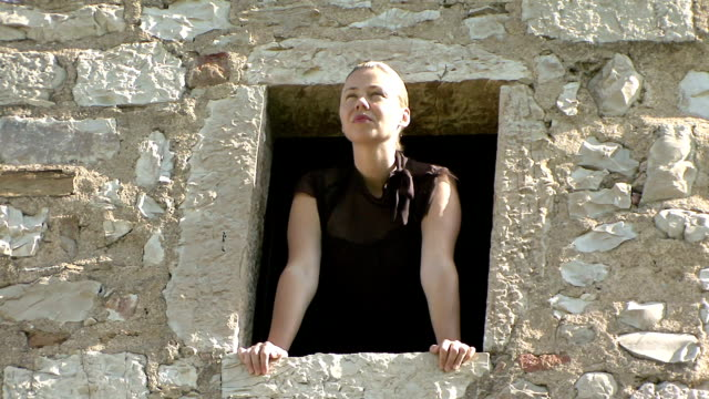 cu zo woman at window looking outside view / gaiole in chianti, tuscany, italy   - stare in piedi video stock e b–roll