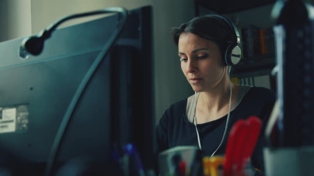 Woman at work with music in the startup office