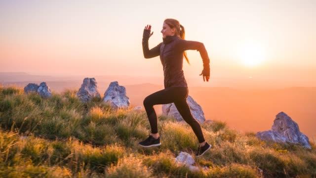 Woman athlete running uphill