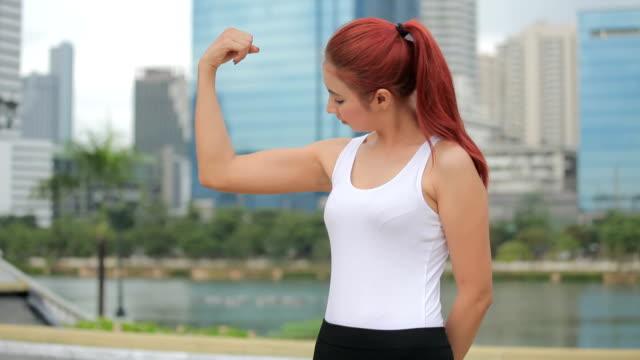 woman athlete showing biceps