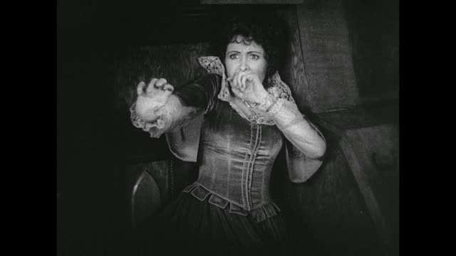 woman attempts to escape from a harassing pirate - silent film stock videos & royalty-free footage
