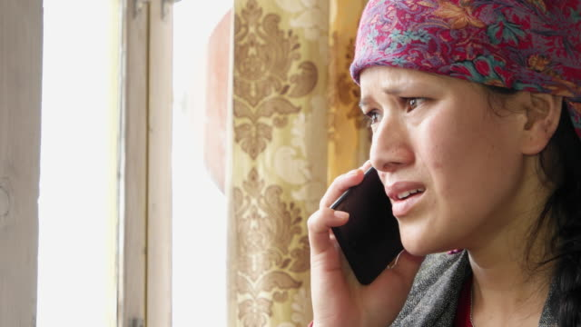 Woman attends a phone call and receives extremely bad news and breaks down