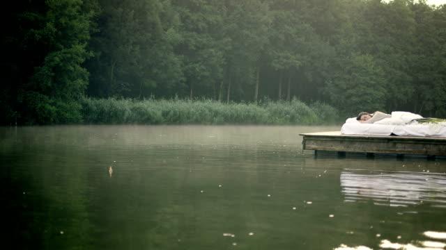 Woman awakening on lake