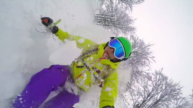 POV Woman backcountry skiing in powder snow