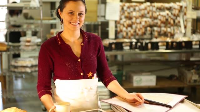 woman baker looking at camera