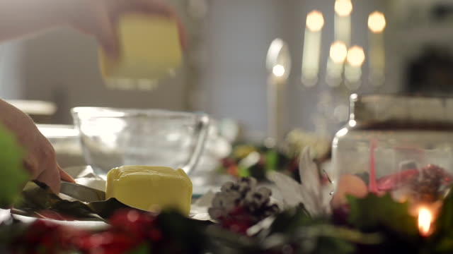 Woman Baking a Christmas Cake Measures Butter into a Glass Bowl
