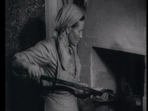 vídeos de stock e filmes b-roll de woman baking dough in oven, children doing homework, wooden house / russia, audio - alimento básico